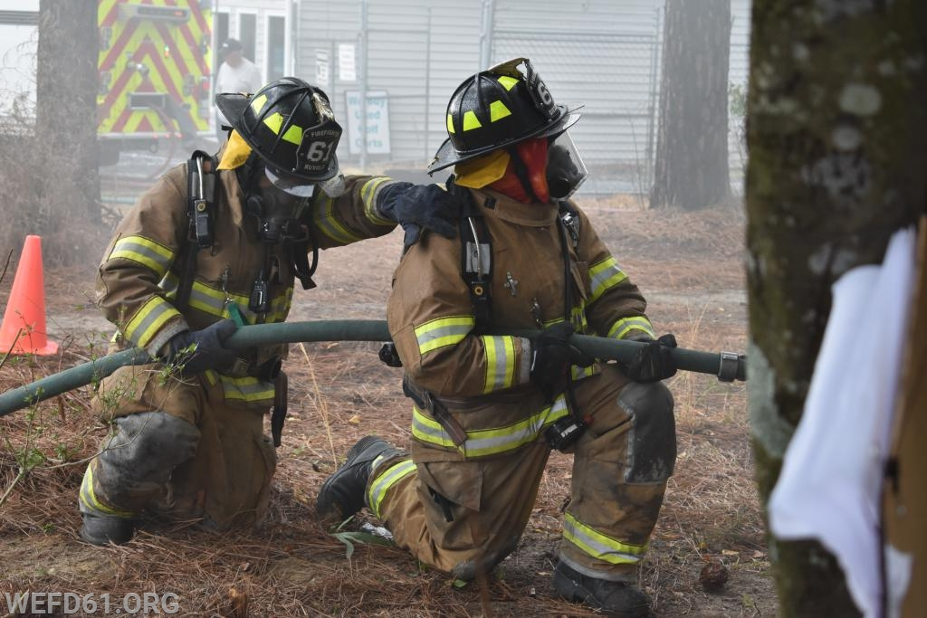 Preparing to enter structure to attack the fire